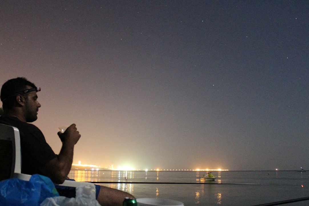 Fishing at night with the stars