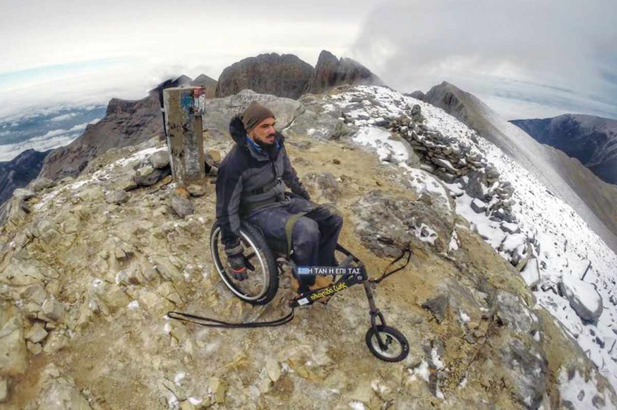 The Cypriot paraplegic who managed to climb to the top of Olympus in a wheelchair!